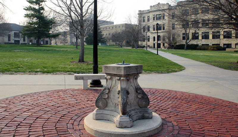 A sundial, gifted by the Kansas State class of 1908, is the focal point of the Quad on the K-State campus on April 5, 2019. (Dene Dryden | Collegian Media Group)