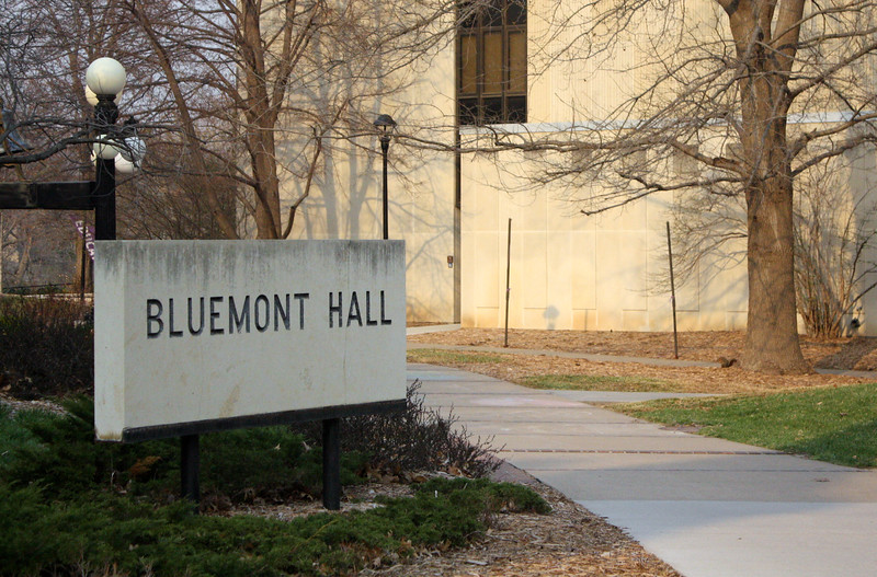 Bluemont Hall's matching limestone sign rests by the outdoor commons on the Kansas State campus on April 5, 2019. (Dene Dryden | Collegian Media Group)