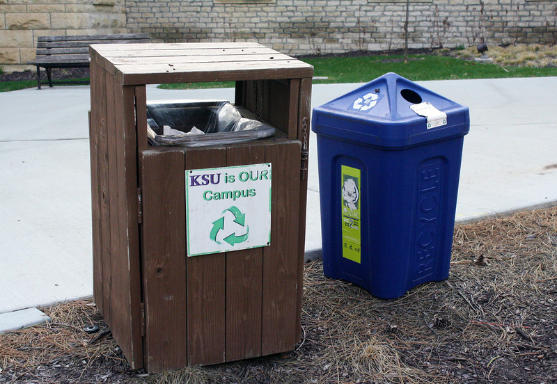 A recycling bin and garbage can are located by a sidewalk on the Kansas State campus on April 5, 2019. (Dene Dryden | Collegian Media Group)