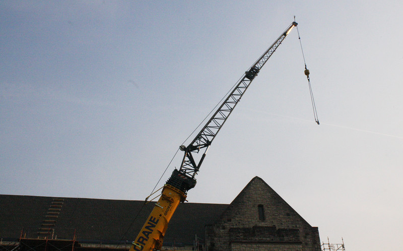 A crane rests by the north side of Hale Library after the workday has ended on the Kansas State campus on April 5, 2019. (Dene Dryden | Collegian Media Group)