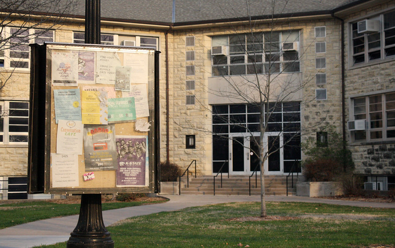 Fliers fill a weatherproofed bulletin board outside of Eisenhower Hall on the Kansas State campus on April 5, 2019. (Dene Dryden | Collegian Media Group)
