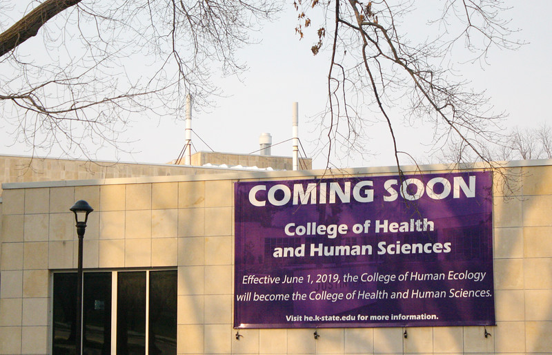 On Justin Hall, a sign notifies passersby about the College of Human Ecology's upcoming name change to the College of Health and Human Sciences on the Kansas State campus on April 5, 2019. (Dene Dryden | Collegian Media Group)