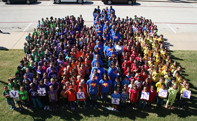 "We have included Character Traits lessons as part of Anderson for the past three years.  Last week was recognized as ""National Character Counts Week', and we are submitting an application this year to try to win an award for the school.  The more press coverage we have, the better.   Each grade level wore a color to represent the six pillars of character.  We took a school-wide picture on Friday to show we are unified pillars of character at CAE.   Red = caring Orange – fairness Yellow – respect Green – responsibility Purple – citizenship Blue – trustworthiness  This was an awesome day.  We caught over 560 acts of character during the week and everyone did a great job at picture time.  The team with the most Character Tickets had music at lunch and a ""dance"" provided by Mr. Williams, our custodian."