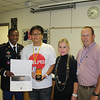 Alex Tran was one of two Summit High School students to receive a U.S. Army Scholar Athlete Award on May 26, 2011. <br /> The students were nominated by the school counseling staff and received a medal and a certificate. Great job!<br /> <br /> Pictured: Staff Sergeant Kwesi Yansen, Alex Tran, SHS Counselor Barbara Herod and SHS Associate Principal Todd Taylor.