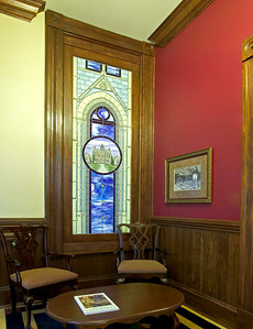 Second floor foyer looking north -- stained glass window covers intersection of roofline of north wing and main building