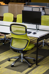 There are fifty computer workstations with monitors on adjustable arms to facilitate collaboration.