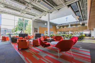 The library features a variety of seating types for individual and group study. This area is just inside the entrance on the main floor.