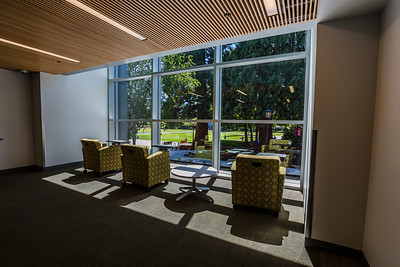 Floor-to-ceiling windows allow natural light into the building.