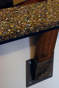 The front desk, sparkling with recycled glass, is supported by recycled wood. Taken by Sarah White '11
