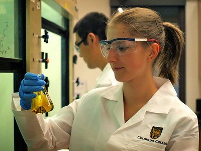 Petra Jans '15 (and Kangmin Kim '14 in background) conduct research toward the synthesis of new medicines for African sleeping sickness. (Lab: Amy Dounay, assistant professor of biology)