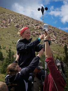 Elizabeth (Betsie) Hopper '15, gets a lift from Matthew Zia '14, while she helps Professor Miro Kummel and Alyssa Fortune '14, fix their meteorological tower on Pikes Peak. They are using the data collected from the tower to gain an understanding of why the tree line on Pikes Peak is rising.