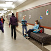 COMING AND GOING: Sleek and sophisticated, the business department hallway find students rushing to make the day's classes on time or relaxing and catching up.