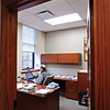OFFICE SPACE: Mark Alexander, assistant chair of the Eckelkamp College of Global Business and Professional Studies, puts in a few office hours in his new second-floor headquarters, a space funded in honor of Joan Nassif Alexander.