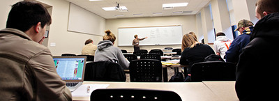 HEAD OF THE CLASS: Anheuser-Busch Hall classrooms are now equipped with white boards, as well as built-in computer and audio-visual technology.