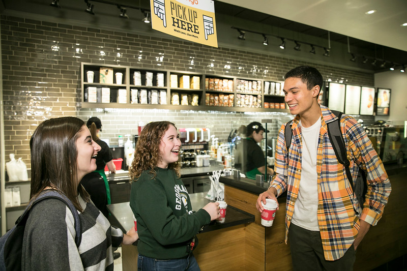 Students at Starbucks.  Photo by:  Ron Aira/Creative Services/George Mason University