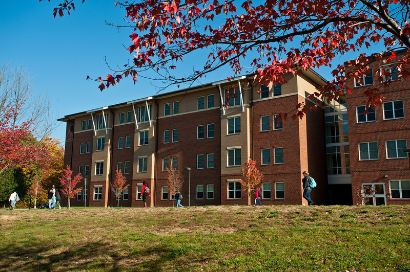 Students walk outside of Liberty Square residence hall.  Photo by Creative Services/George Mason University