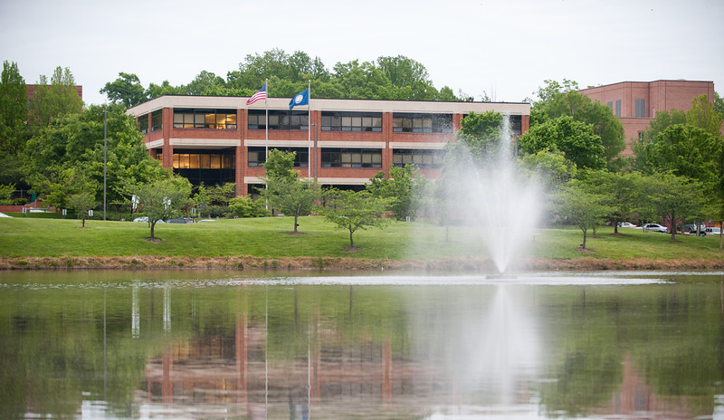 Buchanan Hall and Innovation Hall are seen from Mason Pond at Fairfax Campus. Photo by Alexis Glenn/Creative Services/George Mason University
