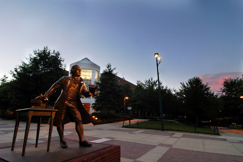 Johnson Center with the Mason Statue at dusk. Photo by Nicolas Tan/Creative Services/George Mason University. 060615001
