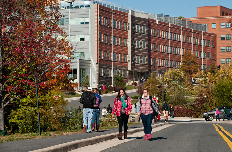 Students walk near the Research Hall at Fairfax Campus.