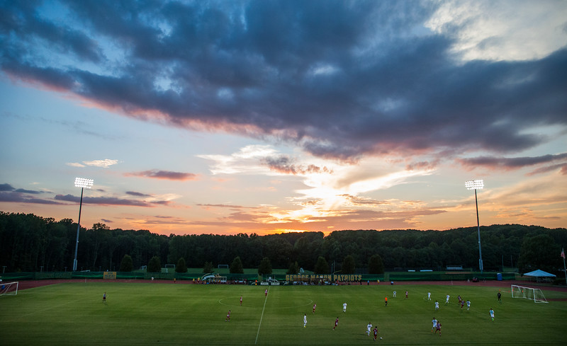 Men's soccer game at sunset
