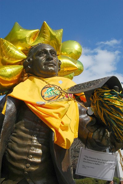 060324551 - It's a tradition at Mason to dress the George Mason statue to mark a variety of events throughout the year. It's also rumored to be good luck to touch his foot. Photo by Evan Cantwell/Creative Services/George Mason University