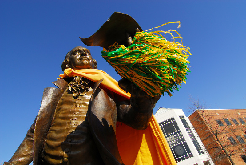 The Mason Statue decked out in green and gold.  Photo by Creative Services/George Mason University