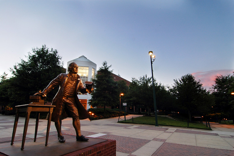 060615001 - The Mason Statue at dawn with the Johnson Center in the background on the Fairfax Campus. Photo by Creative Services/George Mason University