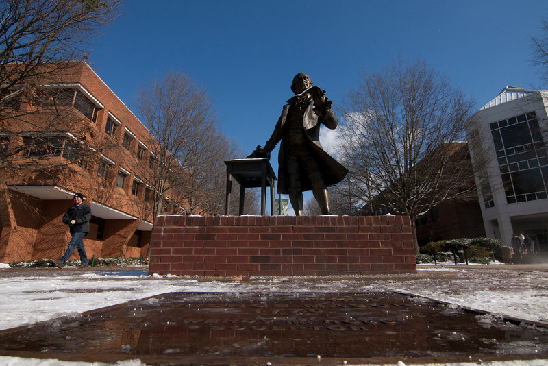 The George Mason statue covered in snow from the first snow fall of 2013 on the Fairfax campus. Photo by Craig Bisacre/Creative Services/George Mason University