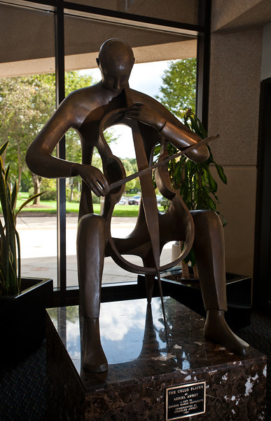 The Cello Player (bronze, 1990) by artist Azriel Awret is seen in the lobby of the Concert Hall of the Center for the Arts. Photo by Alexis Glenn/Creative Services/George Mason University