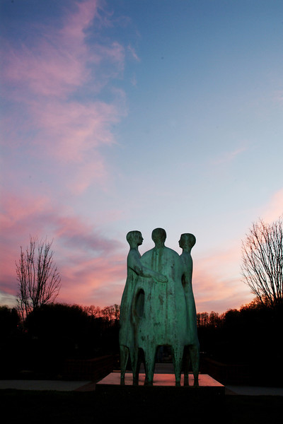 Communitas (bronze, 1992), by artist Azriel Awret on the Fairfax Campus at sunset. Photo by Evan Cantwell/Creative Services/George Mason University
