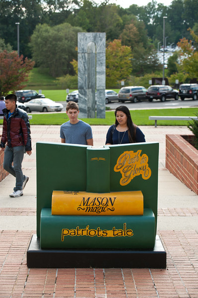 "Path to Glory. Mason students look at ""Path to Glory"" by Bill and Barbara Gordon outside the Center for the Arts. Photo by Alexis Glenn/Creative Services/George Mason University"