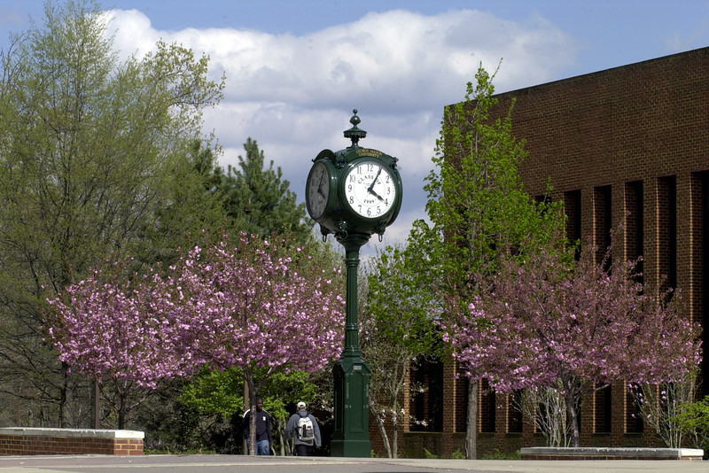 Clock on the North Plaza with King Hall on the right. Photo by Creative Services. Photo by Evan Cantwell/Creative Services/George Mason University