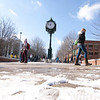 Students attend classes after the first snow fall of 2013 on George Mason Fairfax campus. Photo by Craig Bisacre/Creative Services/George Mason University
