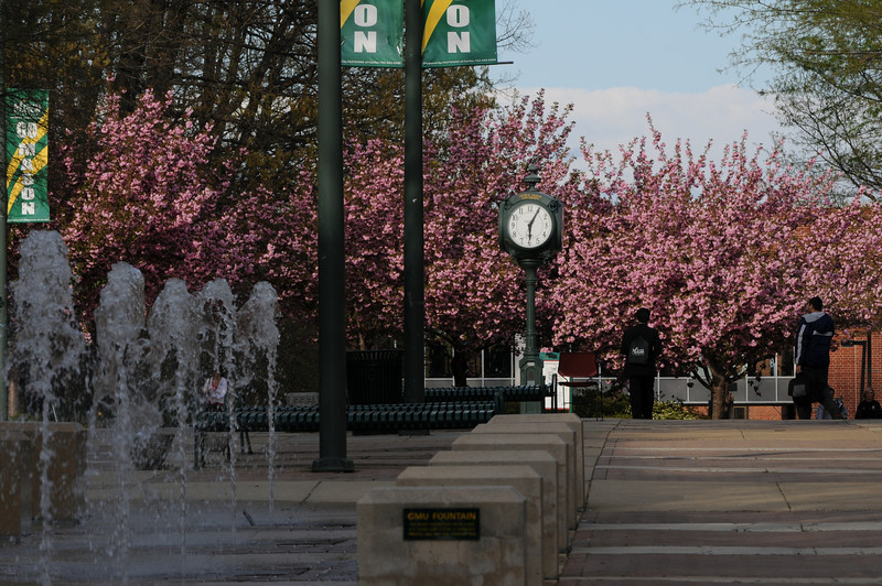 Fountains and clock on North Plaza during Spring on the Fairfax Campus. Photo by Evan Cantwell/Creative Services/George Mason University 090423383