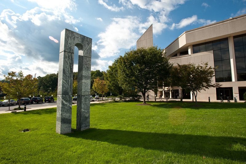 Arch III and Landmark (marble, 1991) by Charters de Almeida. Located outside the Concert Hall of the Center for the Arts.  Photo by Alexis Glenn/Creative Services/George Mason University