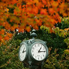 Clock with fall foliage. Photo by Alexis Glenn/Creative Services/George Mason University