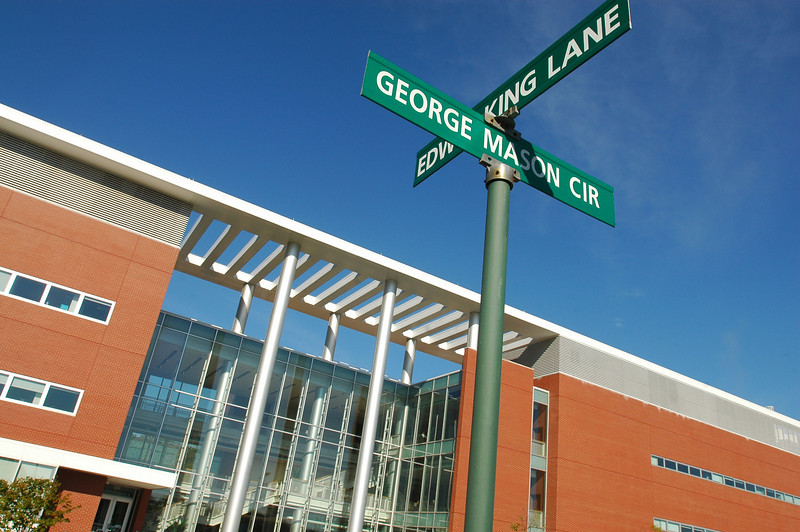 Bull Run Hall on the Science and Technology Campus with street signs.  Photo by Creative Services/George Mason University