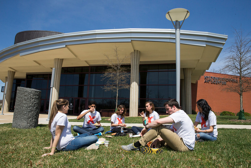 TEDx student volunteers have lunch outside the Hylton Performing Arts Center during the 3rd annual TEDx conference at the Science and Technology Campus. Photo by Craig Bisacre/Creative Services/George Mason University