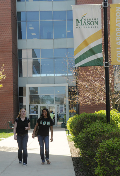 Students walk outside a building on the Science and Technology Campus.  Photo by Creative Services/George Mason University