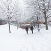 Students walk on the Fairfax Campus in the snow. Photo by Creative Services/George Mason University