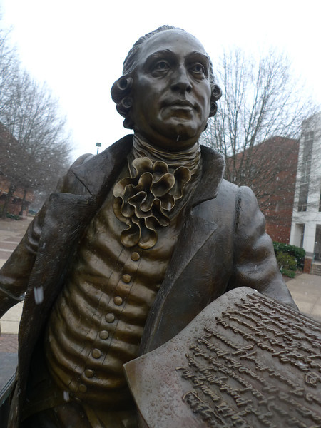George Mason statue in the snow. Photo by Creative Services/George Mason University