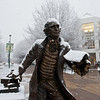 The George Mason statue is seen in the snow at Fairfax campus. Photo by Alexis Glenn/Creative Services/George Mason University