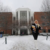 A student leaves the Johnson Center on a snowy day.  Photo by Creative Services/George Mason University
