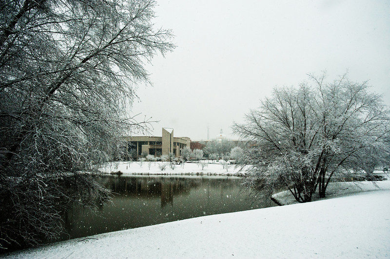 Mason Pond and the Center for the Arts are seen in the snow at Fairfax campus. Photo by Alexis Glenn/Creative Services/George Mason University