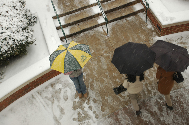 Students walk in the snow. Photo by Creative Services/George Mason University
