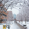 080118133e - Fairfax, VA, Enterprise Hall in winter with students walking in the snow. Photo by Evan Cantwell/Creative Services/George Mason University