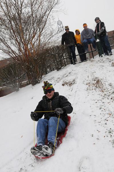 090127045e - Fairfax, VA, Students sled riding. Photo by Creative Services/George Mason University