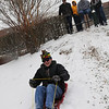 090127045e - Fairfax, VA, Students sled riding. Photo by Creative Services/George Mason University