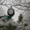 The clock is seen in the snow at Fairfax campus. Photo by Alexis Glenn/Creative Services/George Mason University