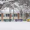 Benches outside SUB I covered in snow on the Fairfax Campus. Photo by Creative Services/George Mason University